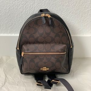 Coach: Mini Charlie Backpack In Signature Canvas